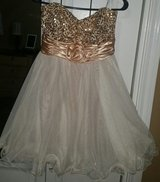 Short gold  dress in Pearland, Texas