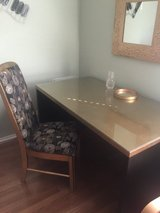 Desk with glass top and chair in Naperville, Illinois