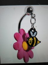 bee and flower belly ring in Camp Lejeune, North Carolina