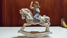 Porcelain little girl on rocking horse in Oswego, Illinois