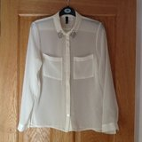 H&M cream blouse in Lakenheath, UK