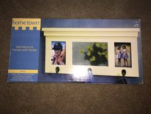 Wall mirror with frames and hooks in New Lenox, Illinois