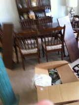 dark wood dining table with 2 leaves and six chairs in Alamogordo, New Mexico