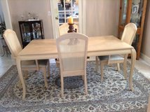 Dinning table, chairs and cabinet in Kingwood, Texas