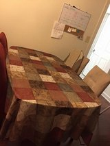 Glass table with 4 chairs in Fort Campbell, Kentucky