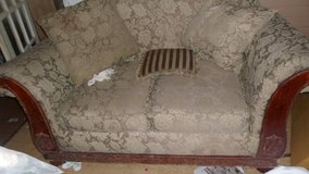 BEIGE OLD COUCH WITH HANDCARVED WOODEN PIECES in Moody AFB, Georgia