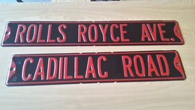 Cadillac and Rolls Royce metal signs in Shorewood, Illinois