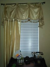 antique looking gold curtains in Spring, Texas