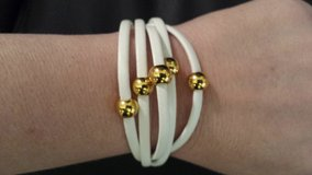 White and gold faux leather bracelet in Greenville, North Carolina