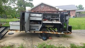 Fully enclosed utility bed on trailer in Fort Polk, Louisiana