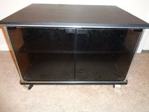 TV table/stand with wheels (2 shelves with class doors) in Fort Polk, Louisiana