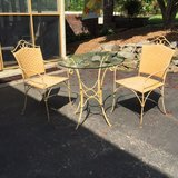 **PRICE REDUCED AGAIN** Antique Wrought Iron and Woven Rattan Table and Chairs in Fort Campbell, Kentucky