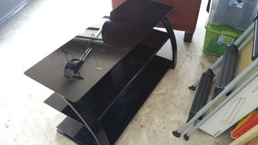 Glass entertainment stand in Baytown, Texas