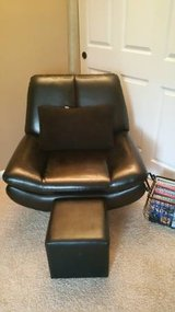 Contemporary Black Leather Swivel Chair with Ottoman in Elgin, Illinois