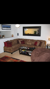 Couch with decorative pillows in San Clemente, California