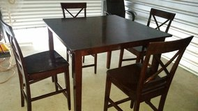 Height table set with 4 barstools in Fort Bliss, Texas