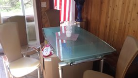 Table made of glass with extra 6 chairs in Schaumburg, Illinois