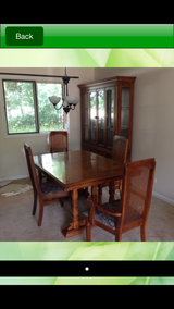 China Cabinet and dining table and 8 chairs in St. Charles, Illinois