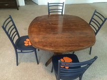 Solid wood table with chairs in Fort Leonard Wood, Missouri
