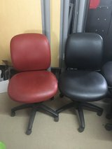 2 red 2 black office chairs in Fort Leonard Wood, Missouri