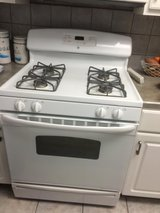 GE side by side refrigerator, Range, over range microwave. This is a full kitchen except dishwasher in Baytown, Texas