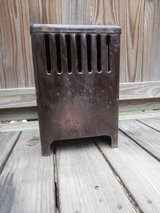 Small vintage brown porcelain gas heater in Cleveland, Texas