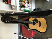 Acoustic guitar with case in Fort Campbell, Kentucky
