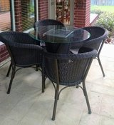 Rattan glass table and chairs in Conroe, Texas
