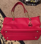 Authentic Michael kors red leather bag in Cleveland, Texas