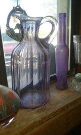 Antique purple bottle and a purple pitcher in Alamogordo, New Mexico