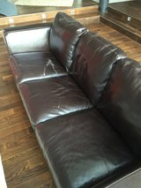 Faux leather couch and love seat in Spangdahlem, Germany