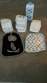 REDUCED!-15 Piece Lot Of Baby Items-(12 Size 5 Pampers Diapers, 1 Chicago White Sox Bib) in Kissimmee, Florida