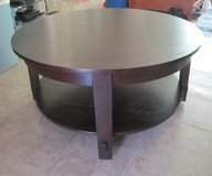 Deep Brown Round Coffee Table with caster wheels in Fort Leonard Wood, Missouri