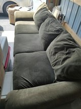 Olive green sofa in Oswego, Illinois