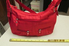 "A New Red ""Go Anywhere"" Shoulder Bag in Kingwood, Texas"