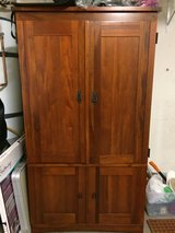 Solid wood armoire in Camp Pendleton, California