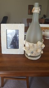 Decorative bottle and matching frame in Watertown, New York