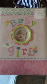 Baby girl memory book. Never used. Has a lot of pages up to year old in Camp Pendleton, California