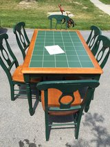 Green tile table with 6 chairs in Fort Drum, New York