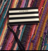 Michael kors wallet wristlet never used in Travis AFB, California