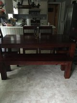 Solid dark wood dining table and chairs in Greensboro, North Carolina