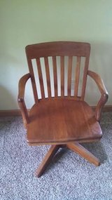 Antique solid wood Chair. Swivels and rocks.  Excellent condition in Joliet, Illinois