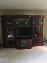 Solid cherry wood entertainment center in Algonquin, Illinois