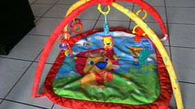 Infant play mat w/ toys in Ramstein, Germany