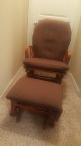 Wooden glider with ottoman and cushions in Kingwood, Texas