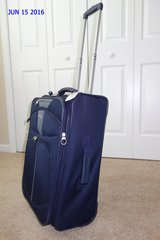 American Tourister Carry On Suitcase Retractable Handle w/Wheels (Dark Blue) in Cherry Point, North Carolina