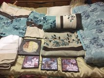 Bedspread, matching pillows, shams, bed skirt, shower curtain with decorative hooks, and pictures in Warner Robins, Georgia