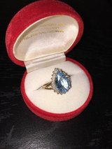 10 karat  ladies ring light blue center stone . 4gr. size 7.5  very beautiful! in 29 Palms, California