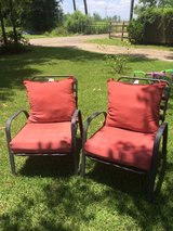 Two lawn chairs with cushions in Conroe, Texas