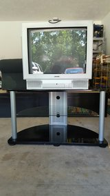 Tv stand (with tv) in Lake Charles, Louisiana
